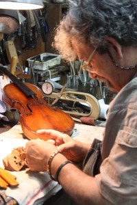 Amnon works on a violin